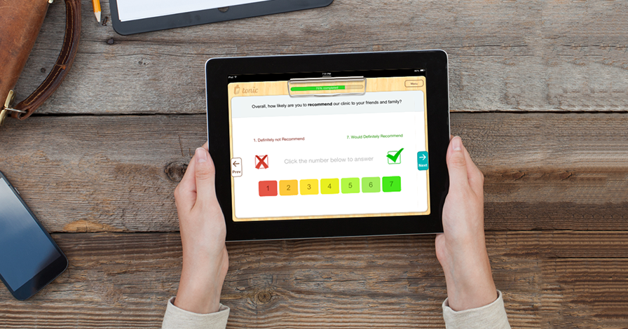 An image with a human holding an iPad with a Tonic Health's Patient Satisfaction survey screen on it.